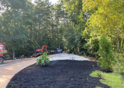 Cleared and leveled extra parking, plus laid some mulch!